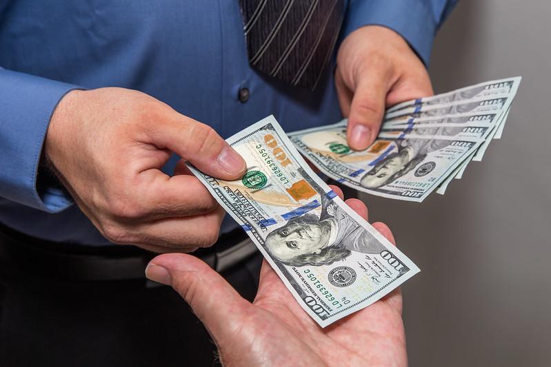 Human Hands Exchanging Money 6
