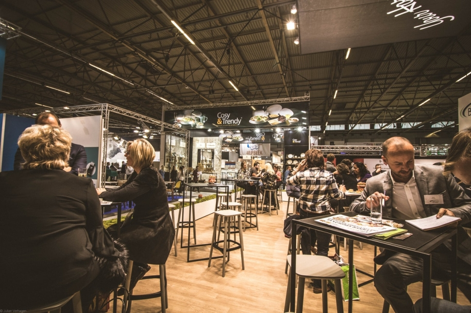 people-inside-a-cafe-with-tables-and-chairs-860227