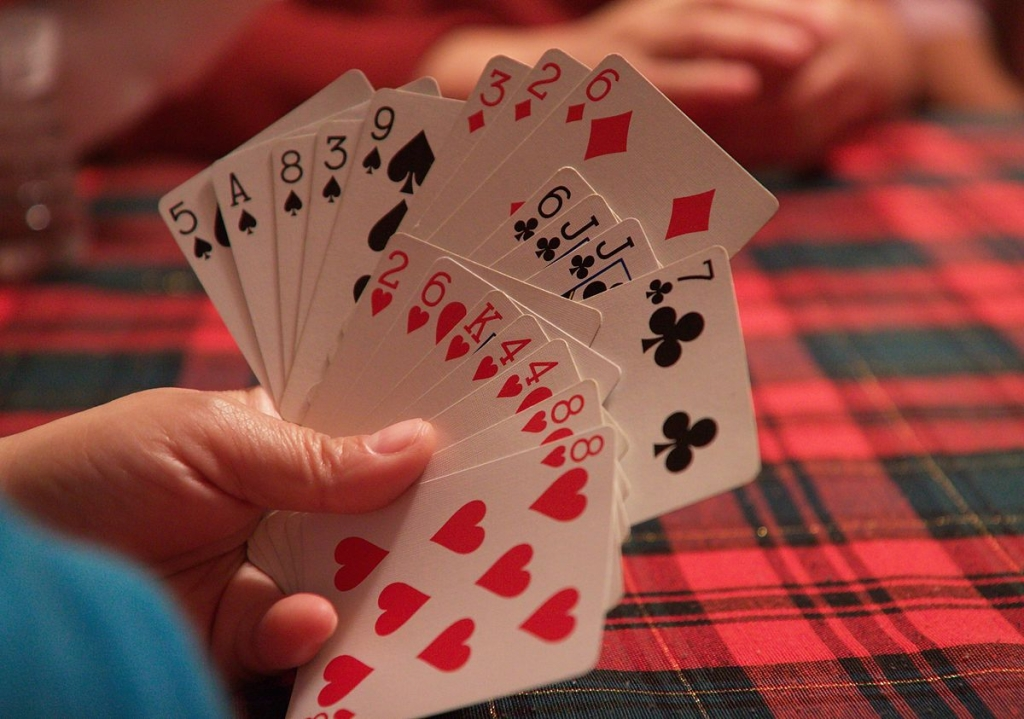 1200px-Hand_of_cards